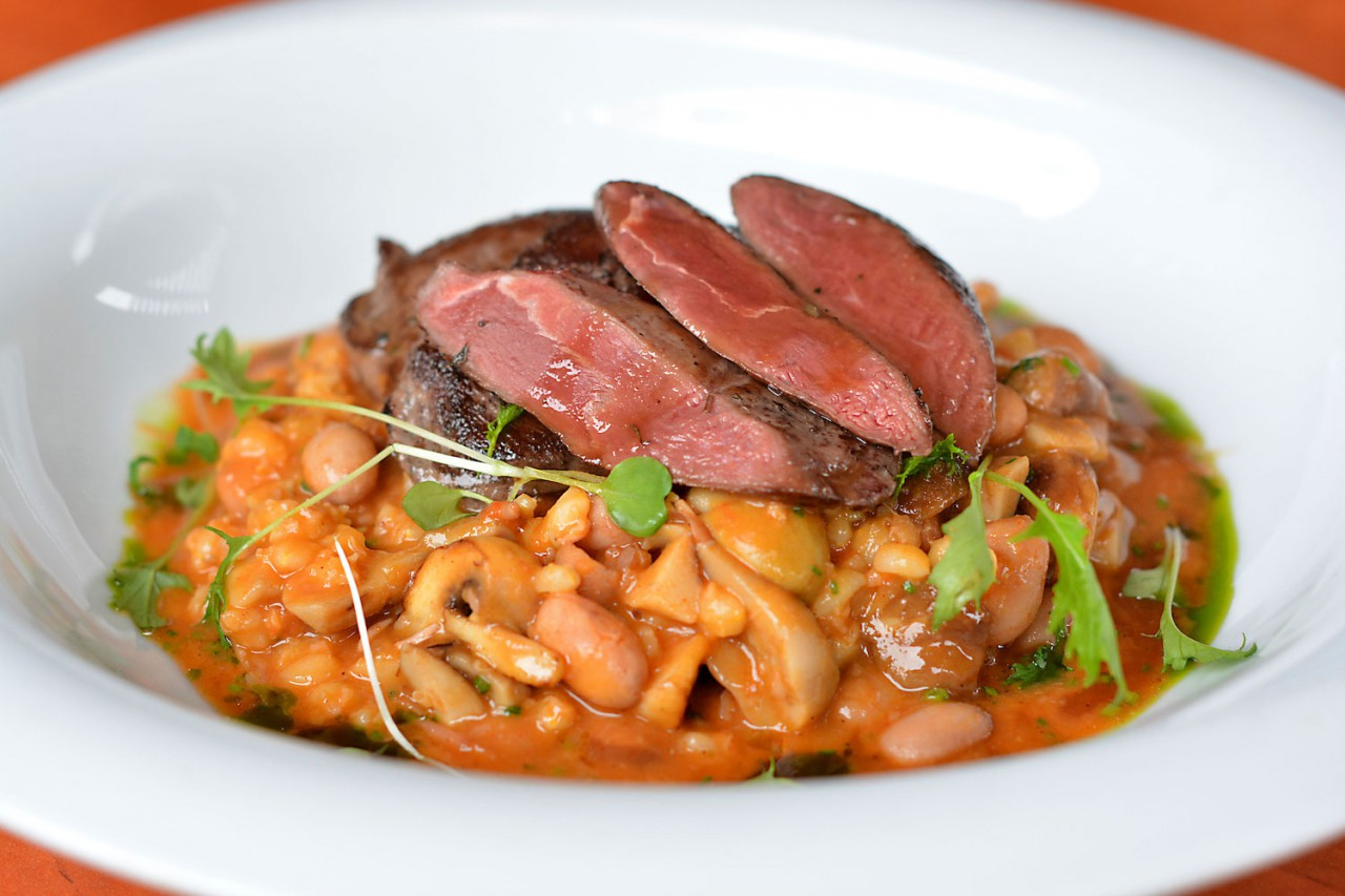 Wild duck breast with cholent and mushrooms